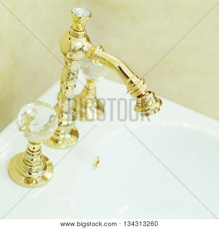 Toilet bidet faucet - bathroom furniture (shallow depth of field)