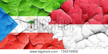 Equatorial guinea flag with Indonesia flag on a grunge cracked w