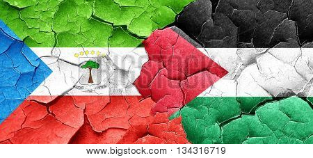 Equatorial guinea flag with Palestine flag on a grunge cracked w