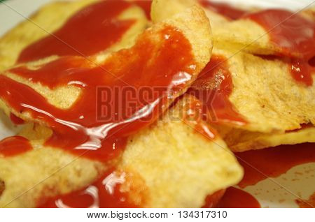a snack of crunchy mexican crisps with spicy sauce