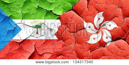 Equatorial guinea flag with Hong Kong flag on a grunge cracked w