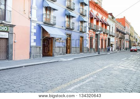 Puebla Mexico - November 7 2014: People stroll the streets of the beautiful colonial city of Puebla in Mexico