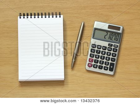 Notebook Pen And Calculator On Desk