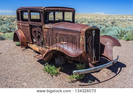 Rusted Carcass Of Old Abandoned Car At Historic Route 66 In Arizona,  Usa