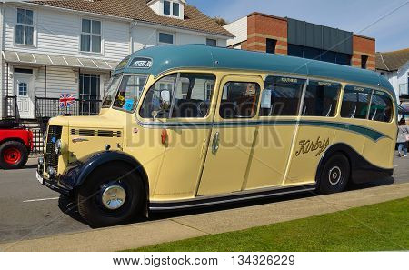 Felixstowe, Suffolk, England - May 01, 2016: Vintage Cream and Green 1950 Duple bus  parked in road.