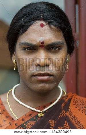 Chettinad India - October 17 2013: Portrait of Ms. Abinaja a Hijra a transgender person a male that dresses and acts like a woman and has a sacred status in Hinduism. Dark stern face and jewelry. Karaikudi city.