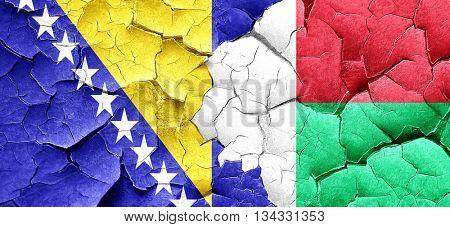Bosnia and Herzegovina flag with Madagascar flag on a grunge cra poster