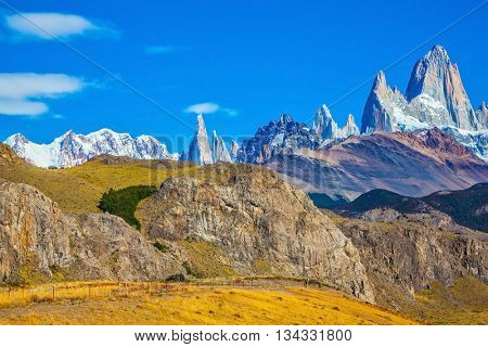 Amazing tops of Mountains Fitzroy are lit with the midday sun. Patagonia in February