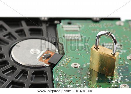 Padlock Sitting On Computer Hard Disk Drive