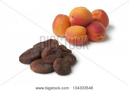 Healthy fresh and sun dried apricot fruit on white background