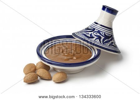 Traditional Moroccan almond amlou and almonds on white background