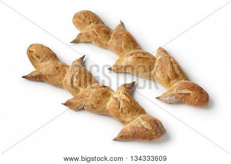 Fresh baked French pain d'epi or wheat stalk bread on white background