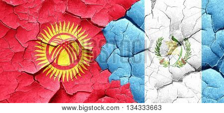 Kyrgyzstan flag with Guatemala flag on a grunge cracked wall