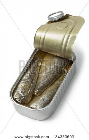 Open tin of sardines in oil on white background