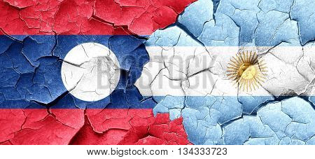 Laos flag with Argentine flag on a grunge cracked wall
