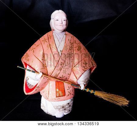 """GOMEL, BELARUS - MAY 24, 2015: The Antique Kimekomi Japanese doll old woman Uba depicting a Noh play, """"The Old Couple from Takasago"""". Japanese traditional dolls are known by the name ningyo in Japan."""