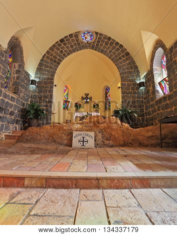 TABGHA, ISRAEL - JANUARY 2012: One of the oldest churches in Sea of Galilee. The masonry of  black stones and altar