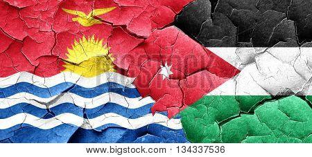 Kiribati flag with Jordan flag on a grunge cracked wall