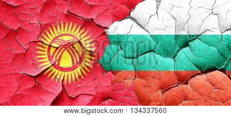 Kyrgyzstan flag with Bulgaria flag on a grunge cracked wall