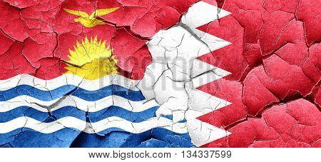 Kiribati flag with Bahrain flag on a grunge cracked wall