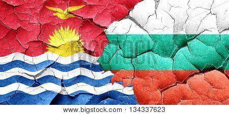 Kiribati flag with Bulgaria flag on a grunge cracked wall