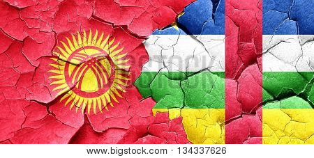 Kyrgyzstan flag with Central African Republic flag on a grunge c