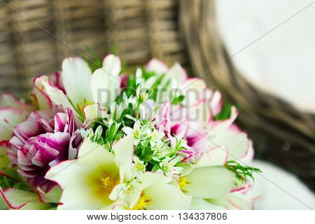 Bouquet of spring flowers on arm chair, closeup