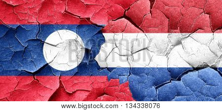 Laos flag with Netherlands flag on a grunge cracked wall