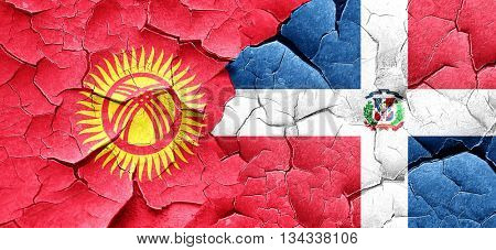 Kyrgyzstan flag with Dominican Republic flag on a grunge cracked