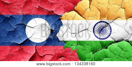 Laos flag with India flag on a grunge cracked wall