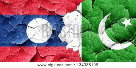 Laos flag with Pakistan flag on a grunge cracked wall