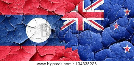 Laos flag with New Zealand flag on a grunge cracked wall