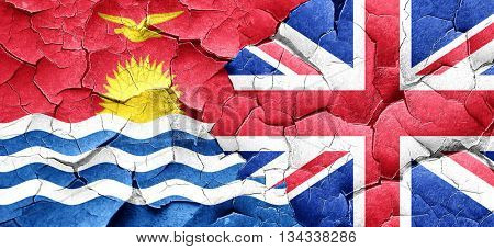 Kiribati flag with Great Britain flag on a grunge cracked wall