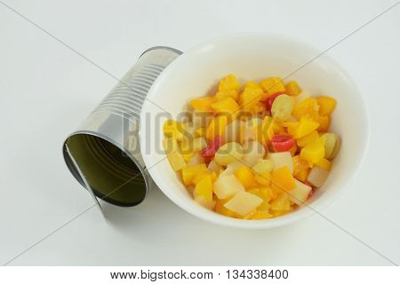 Canned fruit cocktail with can on white background