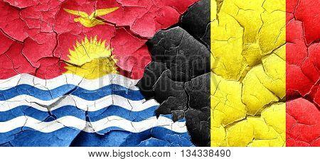 Kiribati flag with Belgium flag on a grunge cracked wall