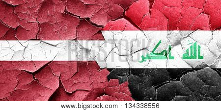 Latvia flag with Iraq flag on a grunge cracked wall
