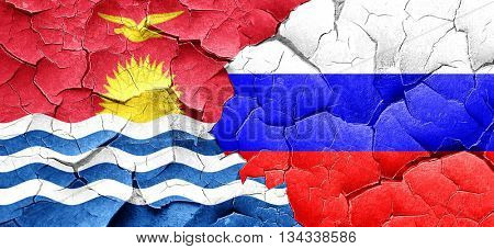 Kiribati flag with Russia flag on a grunge cracked wall