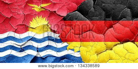 Kiribati flag with Germany flag on a grunge cracked wall