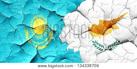 Kazakhstan flag with Cyprus flag on a grunge cracked wall