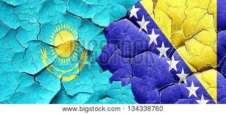 Kazakhstan flag with Bosnia and Herzegovina flag on a grunge cra poster