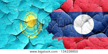 Kazakhstan flag with Laos flag on a grunge cracked wall