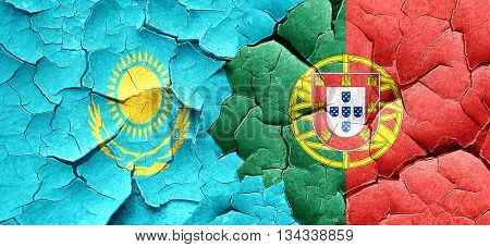 Kazakhstan flag with Portugal flag on a grunge cracked wall