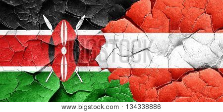 Kenya flag with Austria flag on a grunge cracked wall
