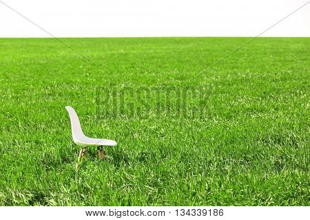 White wooden chair on the wheat field