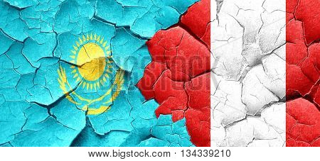 Kazakhstan flag with Peru flag on a grunge cracked wall