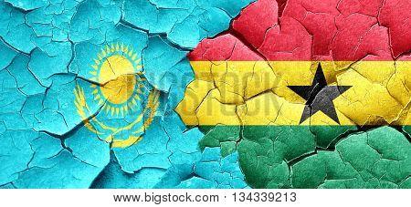 Kazakhstan flag with Ghana flag on a grunge cracked wall