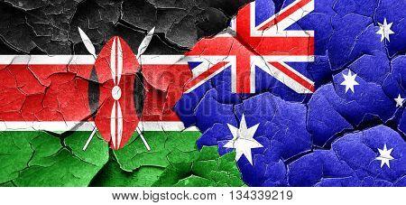 Kenya flag with Australia flag on a grunge cracked wall
