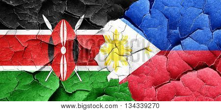 Kenya flag with Philippines flag on a grunge cracked wall