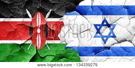 Kenya flag with Israel flag on a grunge cracked wall