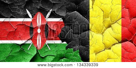 Kenya flag with Belgium flag on a grunge cracked wall